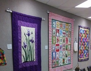 quilts hanging from wall
