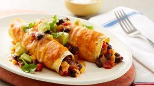 Two yummy enchiladas on a plate.