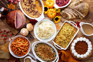Table laden with Thanksgiving food.