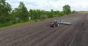 Tractor tilling a field